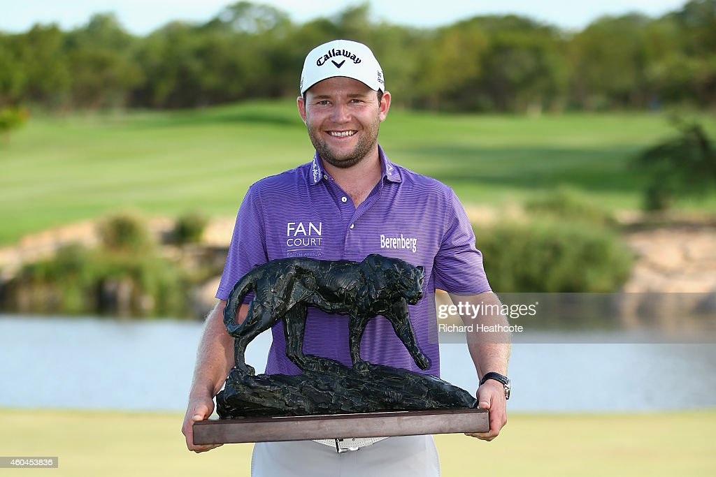 <a gi-track='captionPersonalityLinkClicked' href=/galleries/search?phrase=Branden+Grace&family=editorial&specificpeople=4816558 ng-click='$event.stopPropagation()'>Branden Grace</a> of South Africa holds the trophy after securing victory in the final round of the Alfred Dunhill Championship at Leopard Creek Country Golf Club on December 14, 2014 in Malelane, South Africa.