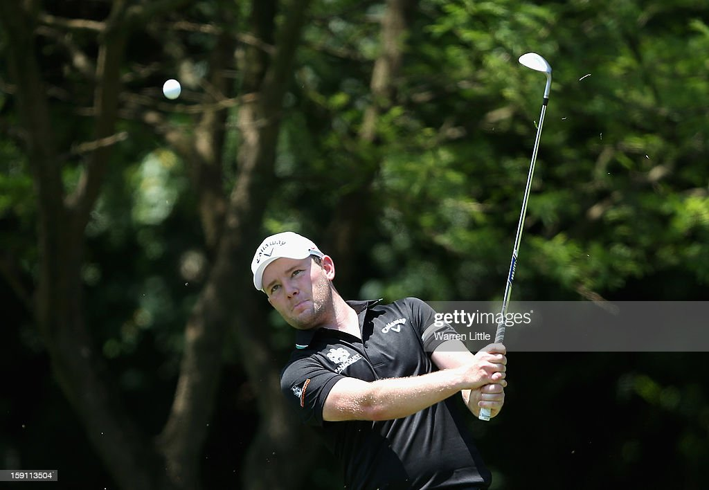 <a gi-track='captionPersonalityLinkClicked' href=/galleries/search?phrase=Branden+Grace+-+Golfer&family=editorial&specificpeople=4816558 ng-click='$event.stopPropagation()'>Branden Grace</a> of South Africa in action during a practice round ahead of the Volvo Golf Champions at Durban Country Club on January 8, 2013 in Durban, South Africa.