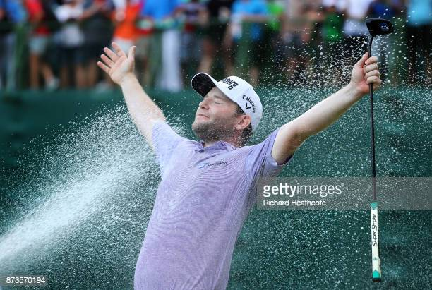 Branden Grace of South Africa is sprayed with champagne after his victory during the final round of the 2017 Nedbank Golf Challenge at Gary Player CC...