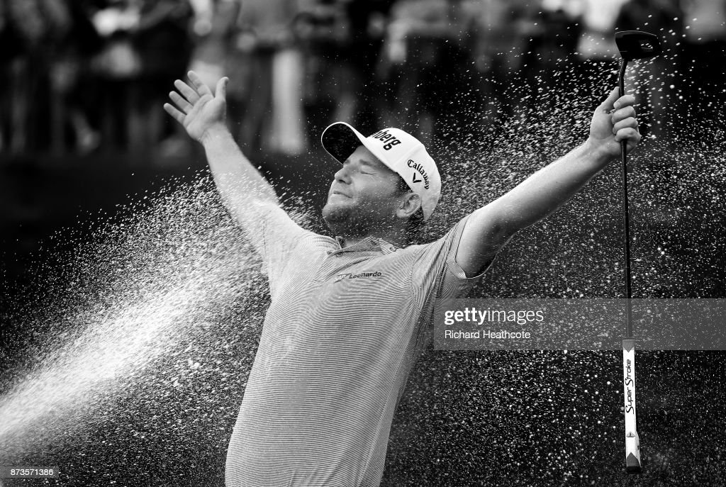 Branden Grace of South Africa is sprayed with champagne after his victory during the final round of the 2017 Nedbank Golf Challenge at Gary Player CC on November 12, 2017 in Sun City, South Africa.
