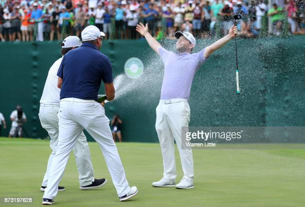 Branden Grace of South Africa is sprayed with champagne on the 18th green during the final round of the Nedbank Golf Challenge at Gary Player CC on...