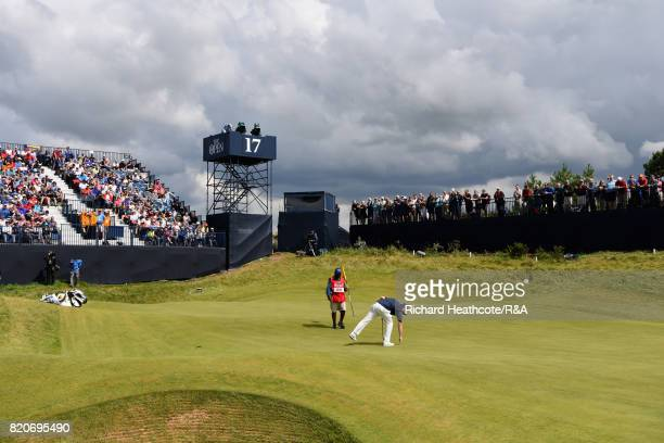 Branden Grace of South Africa picks his ball out of the hole on the 17th green uring the third round of the 146th Open Championship at Royal Birkdale...
