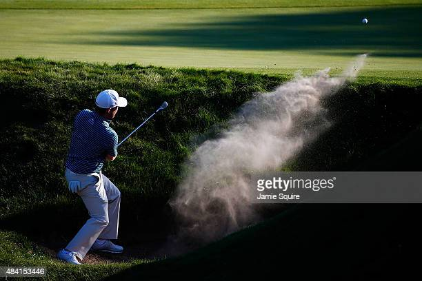 Branden Grace of South Africa plays a bunker shot on the 18th hole during the third round of the 2015 PGA Championship at Whistling Straits on August...