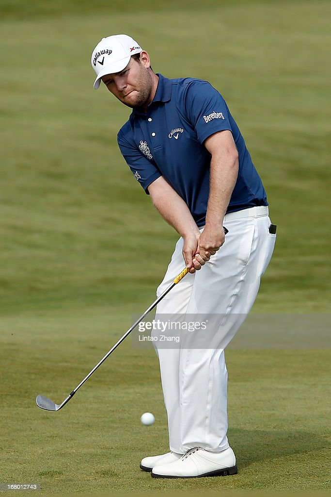 <a gi-track='captionPersonalityLinkClicked' href=/galleries/search?phrase=Branden+Grace&family=editorial&specificpeople=4816558 ng-click='$event.stopPropagation()'>Branden Grace</a> of South Africa plays a shot during the third day of the Volvo China Open at Binhai Lake Golf Course on May 4, 2013 in Tianjin, China.