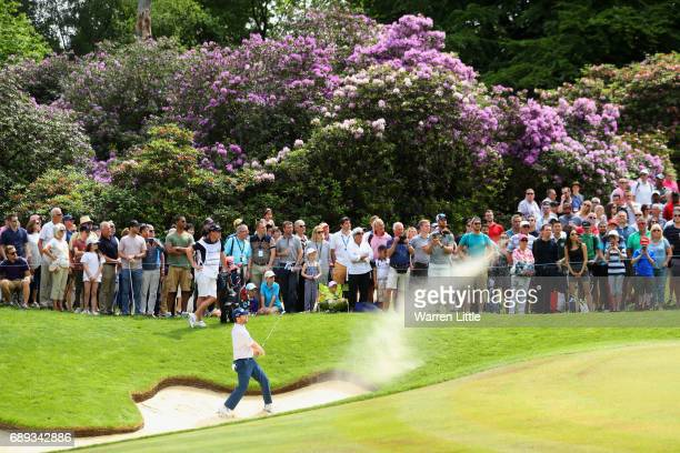 Branden Grace of South Africa plays from a bunker on the 3rd hole during the final round on day four of the BMW PGA Championship at Wentworth on May...