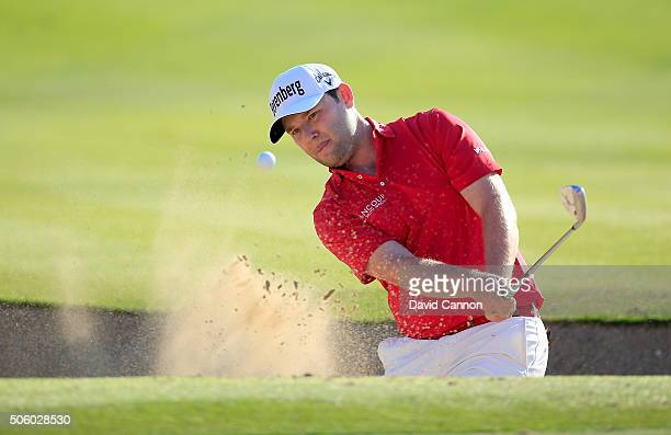 Branden Grace of South Africa plays his fourth shot at the par 4 17th hole during the first round of the 2016 Abu Dhabi HSBC Golf Championship at the...