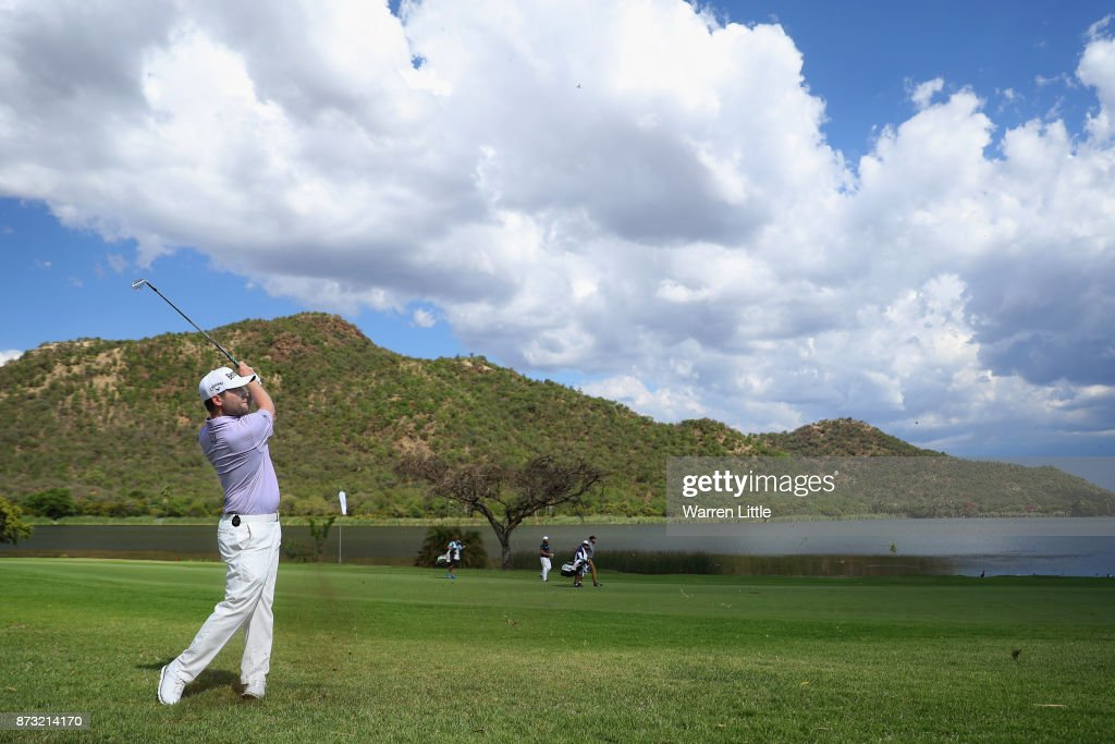 Branden Grace of South Africa plays his second shot into the 17th green during the final round of the Nedbank Golf Challenge at Gary Player CC on November 12, 2017 in Sun City, South Africa.