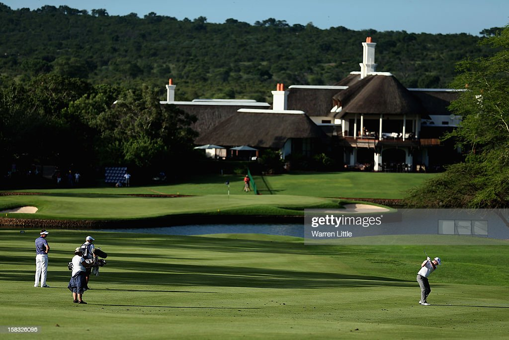Branden Grace of South Africa plays his second shot into the 18th green during the first round of the Alfred Dunhill Championship at Leopard Creek Country Golf Club on December 13, 2012 in Malelane, South Africa.