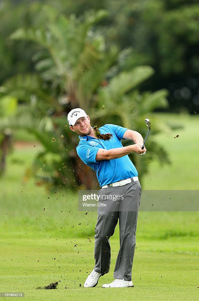 Branden Grace of South Africa plays his second shot into the first green during the first round of The Nelson Mandela Championship presented by ISPS Handa at Royal Durban Golf Club on December 8, 2012 in Durban, South Africa.