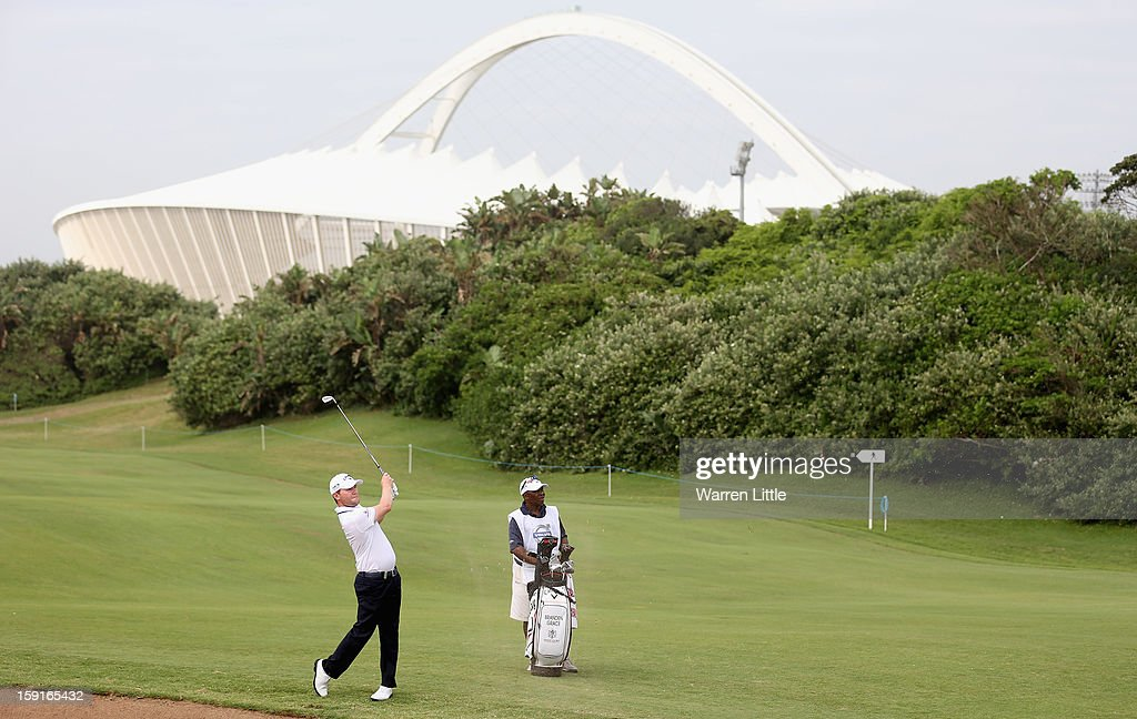<a gi-track='captionPersonalityLinkClicked' href=/galleries/search?phrase=Branden+Grace+-+Golfer&family=editorial&specificpeople=4816558 ng-click='$event.stopPropagation()'>Branden Grace</a> of South Africa plays his second shot into the first green during the Pro-Am for the Volvo Golf Champions at Durban Country Club on January 9, 2013 in Durban, South Africa.