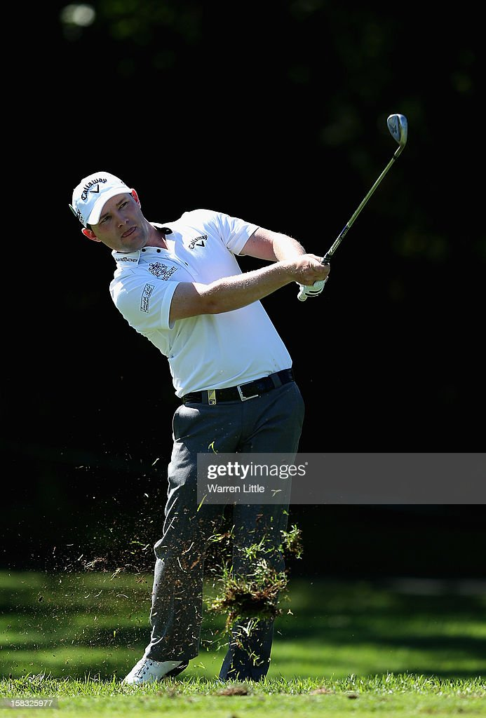 Branden Grace of South Africa plays his second shot on the 11th hole during the first round of the Alfred Dunhill Championship at Leopard Creek Country Golf Club on December 13, 2012 in Malelane, South Africa.