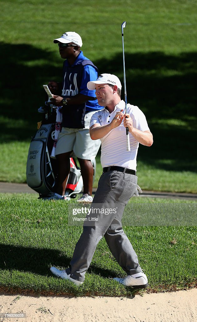Branden Grace of South Africa plays his second shot on the 13th hole during the first round of the Alfred Dunhill Championship at Leopard Creek Country Golf Club on December 13, 2012 in Malelane, South Africa.