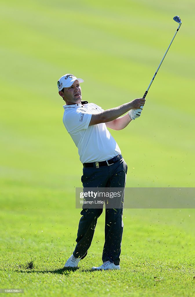 Branden Grace of South Africa plays his second shot on the ninth hole during the first round of the Alfred Dunhill Championship at Leopard Creek Country Golf Club on December 13, 2012 in Malelane, South Africa.