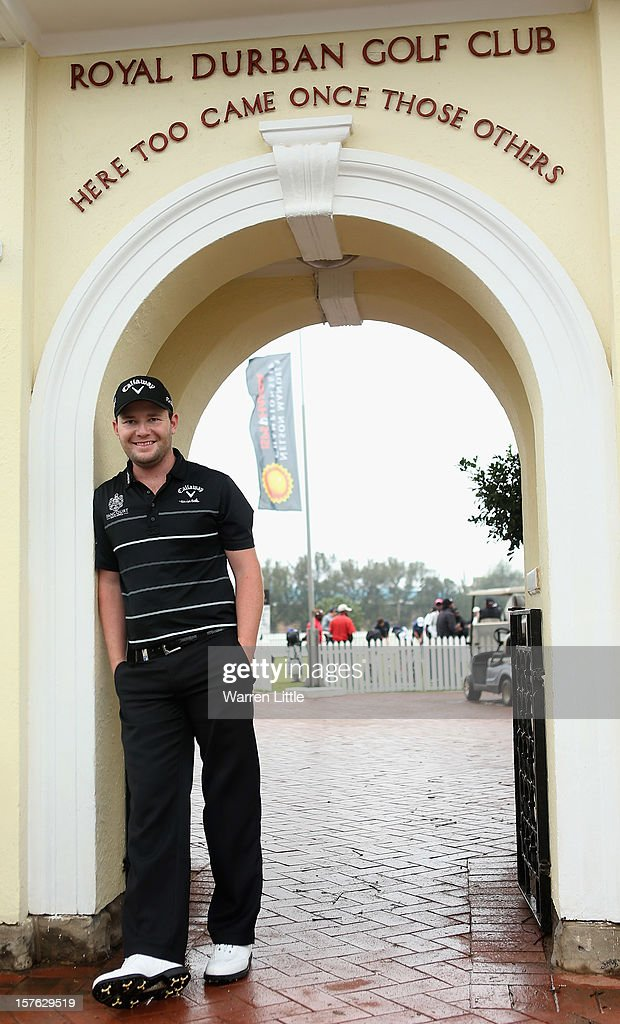 <a gi-track='captionPersonalityLinkClicked' href=/galleries/search?phrase=Branden+Grace&family=editorial&specificpeople=4816558 ng-click='$event.stopPropagation()'>Branden Grace</a> of South Africa poses at the gates of Royal Durban Golf Club ahead of The Nelson Mandela Championship presented by ISPS Handa at Royal Durban Golf Club on December 5, 2012 in Durban, South Africa.