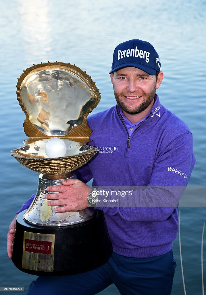 Branden Grace of South Africa poses with the Mother of Pearl trophy following his victory in the Commercial Bank Qatar Masters at the Doha Golf Club on January 30, 2016 in Doha, Qatar.