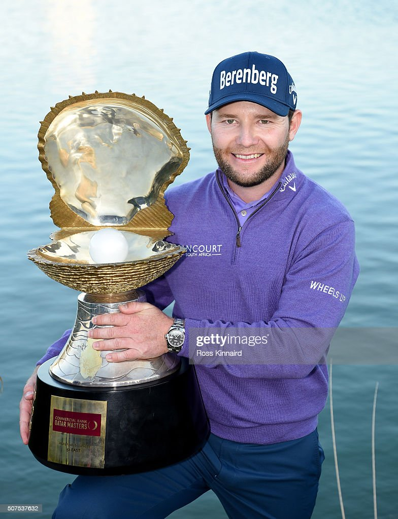 <a gi-track='captionPersonalityLinkClicked' href=/galleries/search?phrase=Branden+Grace&family=editorial&specificpeople=4816558 ng-click='$event.stopPropagation()'>Branden Grace</a> of South Africa poses with the Mother of Pearl trophy following his victory in the Commercial Bank Qatar Masters at the Doha Golf Club on January 30, 2016 in Doha, Qatar.
