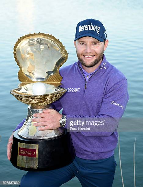 Branden Grace of South Africa poses with the Mother of Pearl trophy following his victory in the Commercial Bank Qatar Masters at the Doha Golf Club...