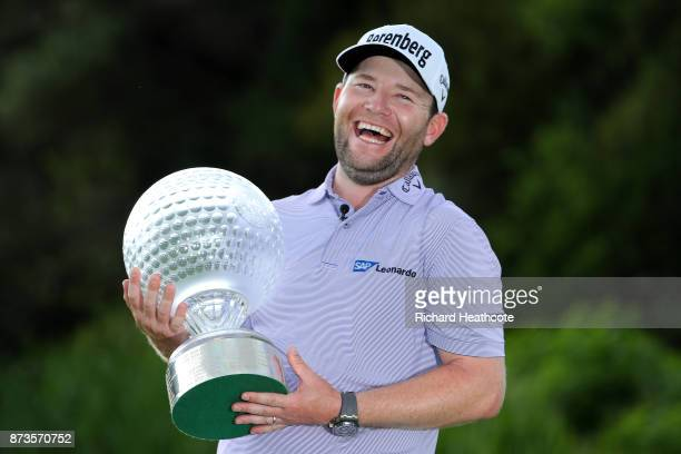 Branden Grace of South Africa poses with the trophy after his victory during the final round of the 2017 Nedbank Golf Challenge at Gary Player CC on...