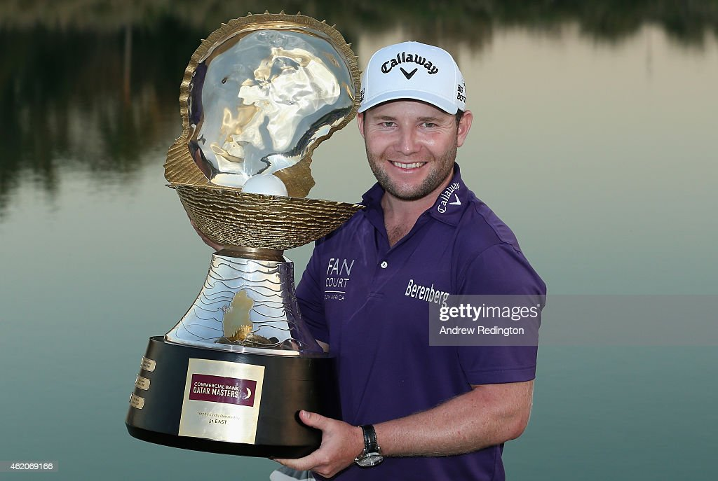 Branden Grace of South Africa poses with the trophy after winning the Commercial Bank Qatar Masters at Doha Golf Club on January 24 2015 in Doha Qatar