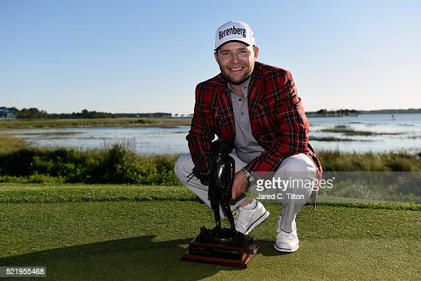 Branden Grace of South Africa poses with the trophy after winning the 2016 RBC Heritage at Harbour Town Golf Links on April 17 2016 in Hilton Head...