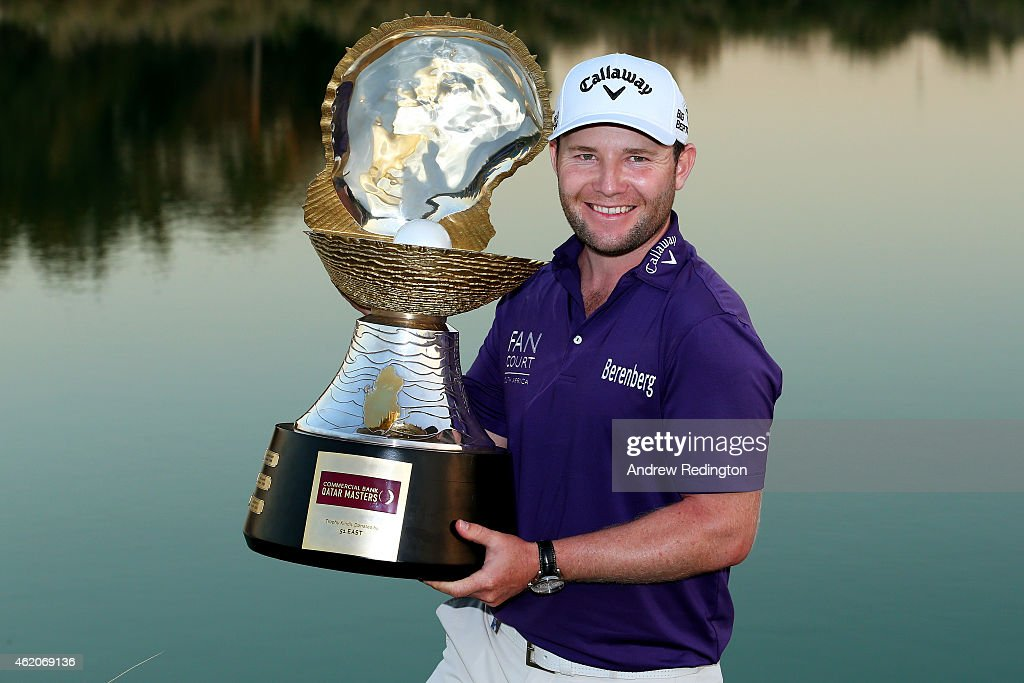 Branden Grace of South Africa poses with the winner's trophy after his victory in the Commercial Bank Qatar Masters at Doha Golf Club on January 24...