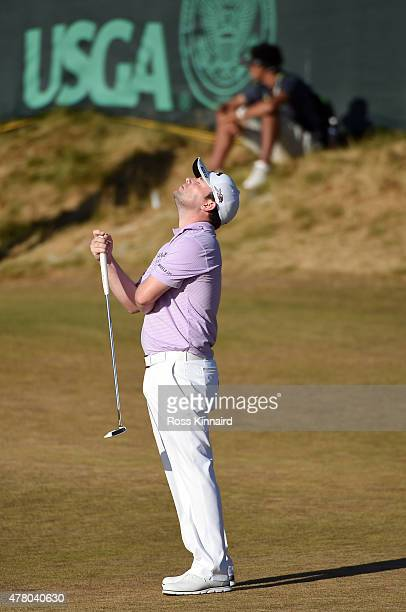 Branden Grace of South Africa reacts to a missed birdie putt on the 17th green during the final round of the 115th US Open Championship at Chambers...