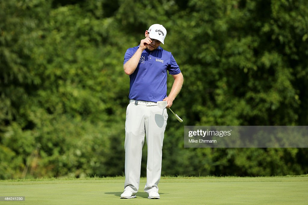 Branden Grace of South Africa reacts to a missed putt on the ninth green during the final round of the 2015 PGA Championship at Whistling Straits on August 16, 2015 in Sheboygan, Wisconsin.