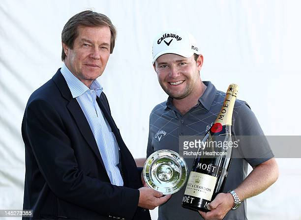 Branden Grace of South Africa receives the European Tour Golfer of the Month Award for January from Chief Executive of the European Tour George...