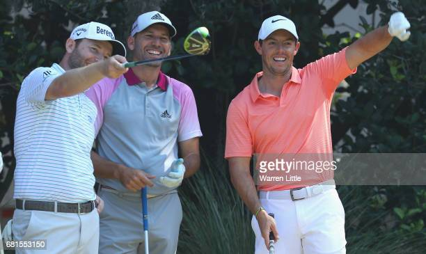 Branden Grace of South Africa Sergio Garcia of Spain and Rory McIlroy of Northern Ireland share a joke during a practice round ahead of THE PLAYERS...