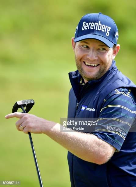 Branden Grace of South Africa smiles after a birdie on the 17th green during the third round of the 146th Open Championship at Royal Birkdale on July...
