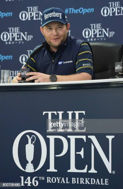 Branden Grace of South Africa talks to the media after shooting a 62 the lowest round in major championship history during the third round of the...