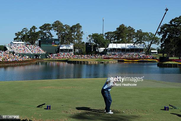 Branden Grace of South Africa tee's off at the 17th during the resumption of the weather delayed second round of THE PLAYERS Championship at the...
