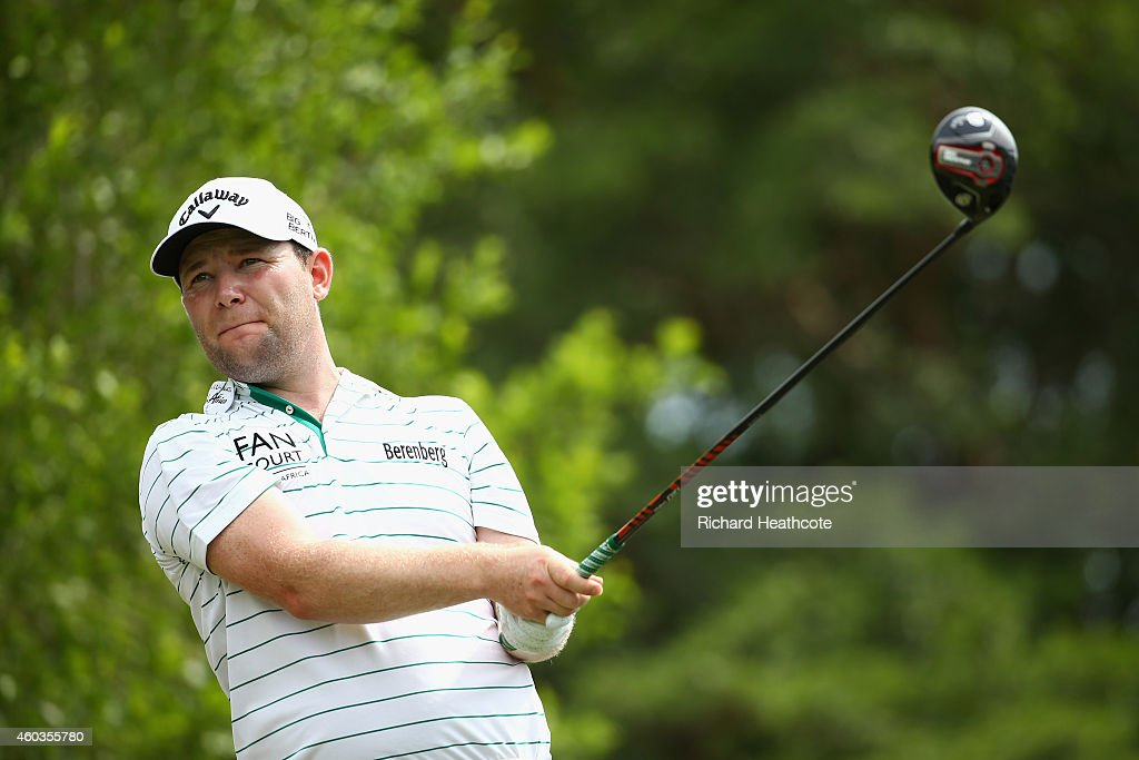 <a gi-track='captionPersonalityLinkClicked' href=/galleries/search?phrase=Branden+Grace&family=editorial&specificpeople=4816558 ng-click='$event.stopPropagation()'>Branden Grace</a> of South Africa tee's off at the 17th during the second round of the Alfred Dunhill Championship at Leopard Creek Country Golf Club on December 12, 2014 in Malelane, South Africa.