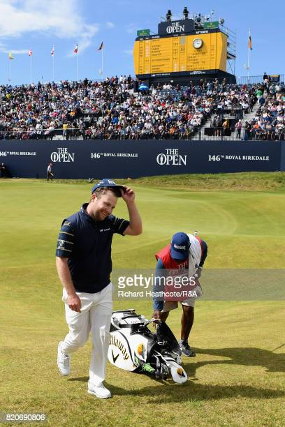 Branden Grace of South Africa walks off the 18th green after shooting a 62 the lowest round in major championship history during the third round of...