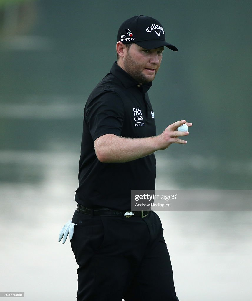 Branden Grace of South Africa waves to the crowd after his birdie on the ninth hole during the first round of the WGC - HSBC Champions at the Sheshan International Golf Club on November 5, 2015 in Shanghai, China.