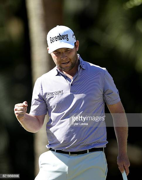 Branden Grace reacts after making a putt on the 13th hole during the final round of the 2016 RBC Heritage at Harbour Town Golf Links on April 17 2016...