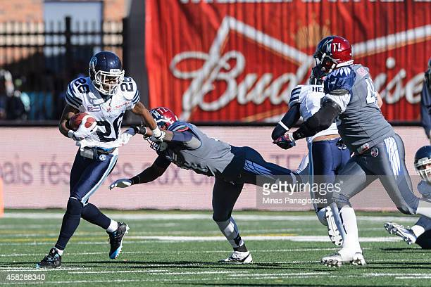 Branden Smith of the Toronto Argonauts avoids a tackle from Mike Edem of the Montreal Alouettes during the CFL game at Percival Molson Stadium on...
