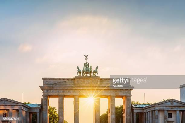 Brandenburg Gate with sun, Berlin, Germany