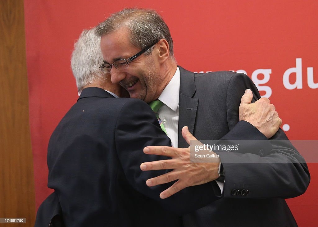 Brandenburg Governor and German Social Democrat (SPD) <a gi-track='captionPersonalityLinkClicked' href=/galleries/search?phrase=Matthias+Platzeck&family=editorial&specificpeople=605525 ng-click='$event.stopPropagation()'>Matthias Platzeck</a> (R) gets a hug from colleague Manfred Stolpe as Platzeck arrives for a meeting of the SPD faction in the Brandenburg state parliament on July 29, 2013 in Potsdam, Germany. Minutes later Platzeck announced that he will resign from office due to health reasons. Once a rising star and even chairman of the SPD, Platzeck has been plagued over the years by problems with his health. Sean Gallup/Getty Images)
