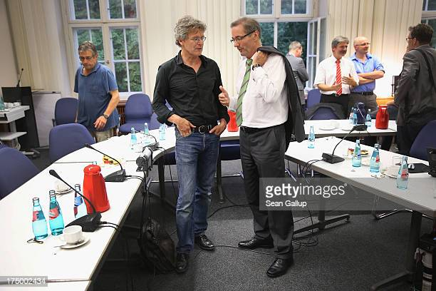 Brandenburg Governor and German Social Democrat Matthias Platzeck chats with a journalist after speaking to the media in which Platzeck announced his...