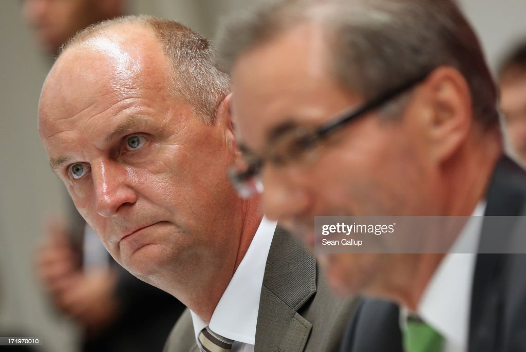 Brandenburg Governor and German Social Democrat (SPD) <a gi-track='captionPersonalityLinkClicked' href=/galleries/search?phrase=Matthias+Platzeck&family=editorial&specificpeople=605525 ng-click='$event.stopPropagation()'>Matthias Platzeck</a> (R) and Brandenburg State Minister of the Interior Dietmar Woidke arrive to speak to the media following a meeting of the SPD faction in the Brandenburg state parliament in which Platzeck announced his resignation on July 29, 2013 in Potsdam, Germany. Platzeck announced that he will resign from office due to health reasons and that Woidke will succeed him as new governor.