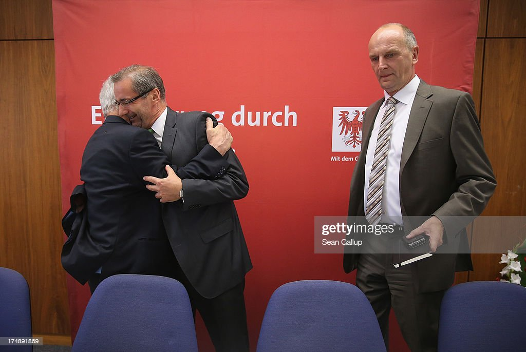 Brandenburg Governor and German Social Democrat (SPD) <a gi-track='captionPersonalityLinkClicked' href=/galleries/search?phrase=Matthias+Platzeck&family=editorial&specificpeople=605525 ng-click='$event.stopPropagation()'>Matthias Platzeck</a> (C) is greeted by colleague Manfred Stolpe as Brandenburg State Minister of the Interior Dietmar Woidke stands by upon their arrival for a meeting of the SPD faction in the Brandenburg state parliament on July 29, 2013 in Potsdam, Germany. Minutes later Platzeck announced that he will resign from office due to health reasons. Once a rising star and even chairman of the SPD, Platzeck has been plagued over the years by problems with his health. Sean Gallup/Getty Images)