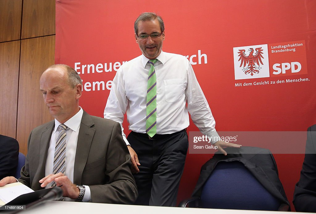 Brandenburg Governor and German Social Democrat (SPD) <a gi-track='captionPersonalityLinkClicked' href=/galleries/search?phrase=Matthias+Platzeck&family=editorial&specificpeople=605525 ng-click='$event.stopPropagation()'>Matthias Platzeck</a> (C) sits down next to Brandenburg State Minister of the Interior Dietmar Woidke upon their arrival for a meeting of the SPD faction in the Brandenburg state parliament on July 29, 2013 in Potsdam, Germany. Minutes later Platzeck announced that he will resign from office due to health reasons. Once a rising star and even chairman of the SPD, Platzeck has been plagued over the years by problems with his health. Sean Gallup/Getty Images)