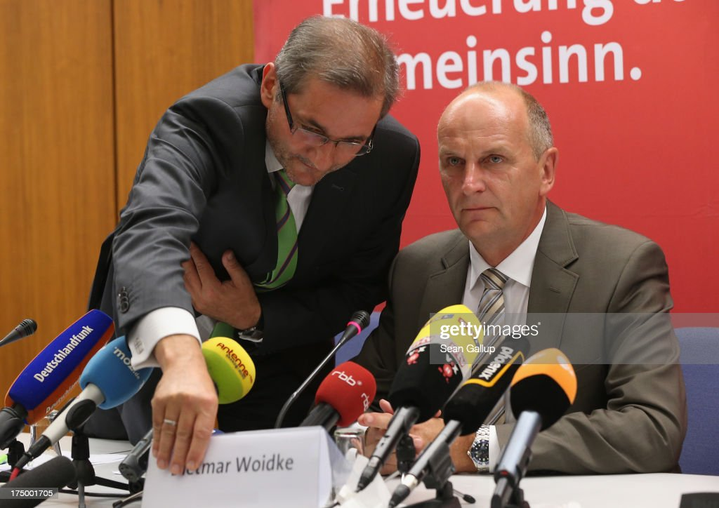 Brandenburg Governor and German Social Democrat (SPD) <a gi-track='captionPersonalityLinkClicked' href=/galleries/search?phrase=Matthias+Platzeck&family=editorial&specificpeople=605525 ng-click='$event.stopPropagation()'>Matthias Platzeck</a> (L) switsches name plates after trading seats with Brandenburg State Minister of the Interior Dietmar Woidke as they speak to the media following a meeting of the SPD faction in the Brandenburg state parliament in which Platzeck announced his resignation on July 29, 2013 in Potsdam, Germany. Platzeck announced that he will resign from office due to health reasons and that Woidke will succeed him as new governor.