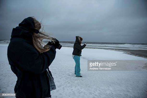 Brandi Brooks from North Cape May and her sister Colie Brooks from North Cape May take pictures on the beach on January 23 2016 in Cape May New...