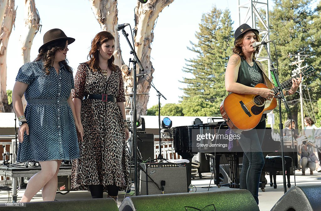 Brandi Carlile (R) performs with guests Laura Rogers and Lydia Rogers of Secret Sisters (L) at Bottle Rock Napa Valley Festival at Napa Valley Expo on May 12, 2013 in Napa, California.