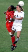 Brandi Chastain and Canadian Charmaine Hooper head the ball 01 July 2000 during their semifinal match in the Women's Gold Cup Tournament game in...