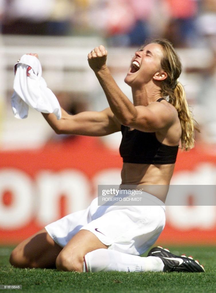Brandi Chastain of the US celebrates after kicking the winning penalty shot to win the 1999 Women's World Cup final against China 10 July 1999 at the...