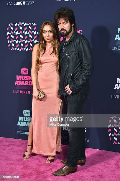 Brandi Cyrus and father Billy Ray Cyrus attends the 2016 CMT Music awards at the Bridgestone Arena on June 8 2016 in Nashville Tennessee