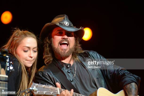 Brandi Cyrus and her dad Billy Ray Cyrus appear on the Cracker Barrel Stage during CMA FEst on June 8 2017 in Nashville Tennessee